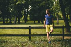 Young man by the wooden fence Royalty Free Stock Images