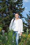 Young man in the woods Royalty Free Stock Image