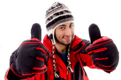Young man in woolen cap and jacket with thumbs up Royalty Free Stock Photos