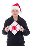 Young man in woolen sweater with christmas gift isolated on whit Royalty Free Stock Photos
