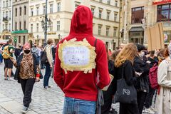 Young man with words on his back about keep distance two meters, social distance