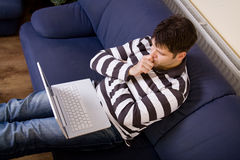 Young man work with computer Stock Photography