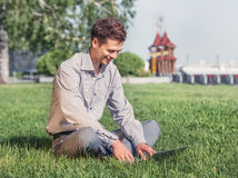 Young man work with laptop in the city park Stock Photography