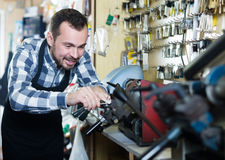 Young man worker working at forming key Royalty Free Stock Photos
