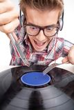 Young man working as dj with ear-phones and glasses. Stock Images