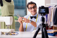 The young man working as fashion video blogger Stock Photo