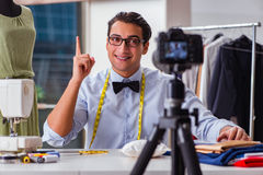 The young man working as fashion video blogger Royalty Free Stock Photo