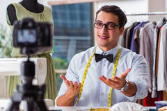 The young man working as fashion video blogger Stock Photos
