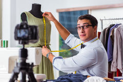 The young man working as fashion video blogger Royalty Free Stock Image