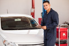 Young man working in an auto shop Royalty Free Stock Photo