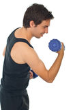 Young man working with barbell Royalty Free Stock Image