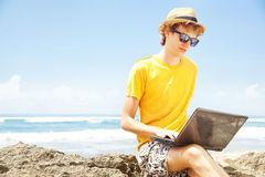 Young man working on a beach Royalty Free Stock Photos