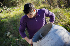 Young man working with a cement mixer Royalty Free Stock Image