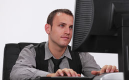 Young man working on a computer Stock Images