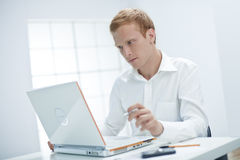 Young Man is Working on the Computer. Stock Photos