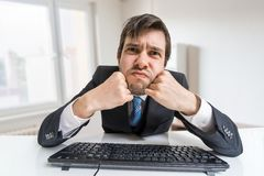 Young man is working with computer and looking at you Royalty Free Stock Photo
