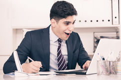 Young man is working at a computer. In the office Stock Images