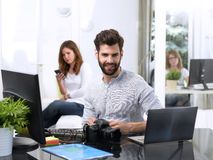 Young man working on computer royalty free stock images