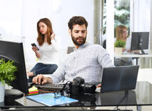 Young man working on computer royalty free stock photos