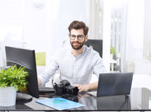 Young man working on computer Stock Images