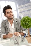Young man working at desk in office Stock Photography