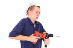 Young man working with drill Stock Photo
