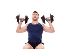 Young man working with dumbbells Stock Image