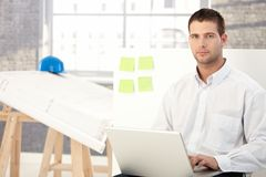 Young man working in engineering office Royalty Free Stock Photo