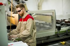 Young man working in the factory stock photos