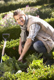 Young man working in garden Royalty Free Stock Images