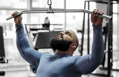 Young man working hard in gym to achieve success in sports, pulldown exercise. Stock footage Royalty Free Stock Images