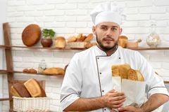 Young man working at his bakery royalty free stock photo