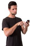 Young Man Working On His Smartphone Stock Photo