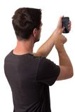 Young Man Working On His Smartphone Royalty Free Stock Images
