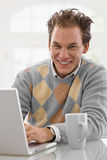 Young man working at home Royalty Free Stock Photography