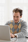 Young man working at home Royalty Free Stock Photos