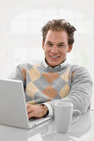 Young man working at home Stock Images