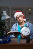 The young man working at home on christmas day Royalty Free Stock Image
