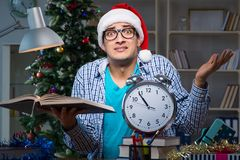 The young man working at home on christmas day Royalty Free Stock Photography