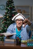 The young man working at home on christmas day Stock Photography