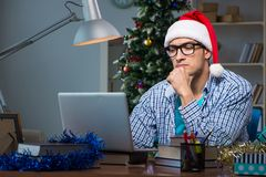 The young man working at home on christmas day Royalty Free Stock Photos