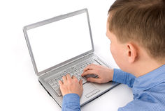 Young man working of a laptop Stock Images