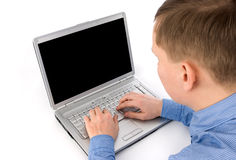 Young man working of a laptop Stock Image
