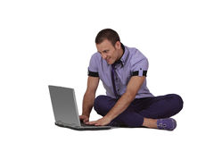Young man working on a laptop Royalty Free Stock Image