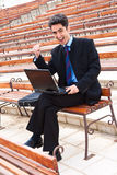 Young man is working on laptop. Stock Photos