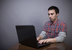 Young man working on laptop Royalty Free Stock Photography