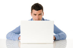 Young man working at laptop Stock Photography