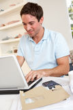 Young man working with laptop computer Royalty Free Stock Images