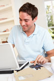 Young man working with laptop computer Royalty Free Stock Photos