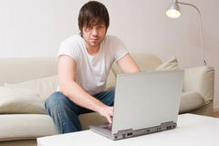 Young man working on laptop computer Stock Image